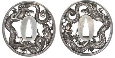A silver tsuba