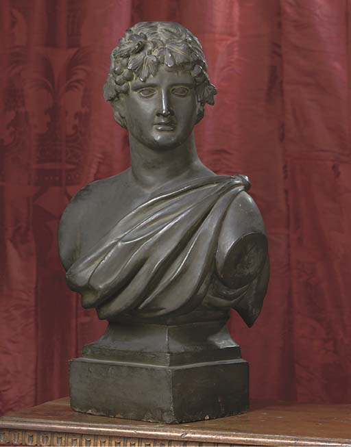 A BRONZED TERRACOTTA BUST OF BACCHUS