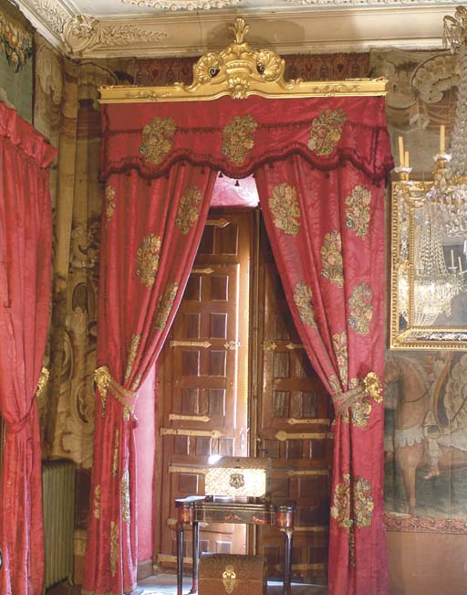 TWO PAIRS OF SPANISH RED SILK DAMASK CURTAINS WITH GILTWOOD PELMETS