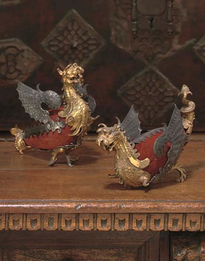 A PAIR OF SILVER AND GILT-COPP