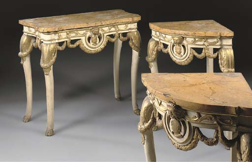 A SPANISH WHITE-PAINTED AND PARCEL-GILT CONSOLE TABLE AND A PAIR OF CORNER CONSOLES EN SUITE