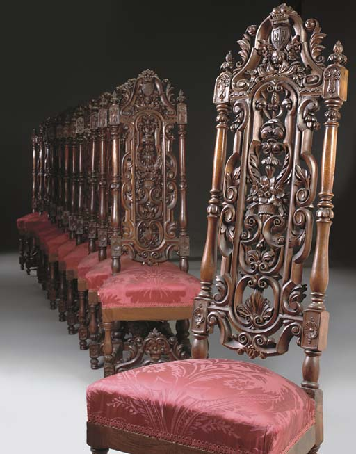 A SUITE OF TWELVE SPANISH CARVED WALNUT TALL SIDE CHAIRS