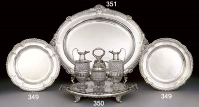 A GEORGE III SILVER FOUR-BOTTL