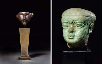 AN EGYPTIAN PURPLISH-BROWN GLA