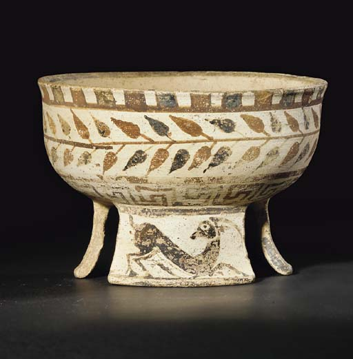 A HELLENISTIC PAINTED POTTERY TRIPOD BOWL