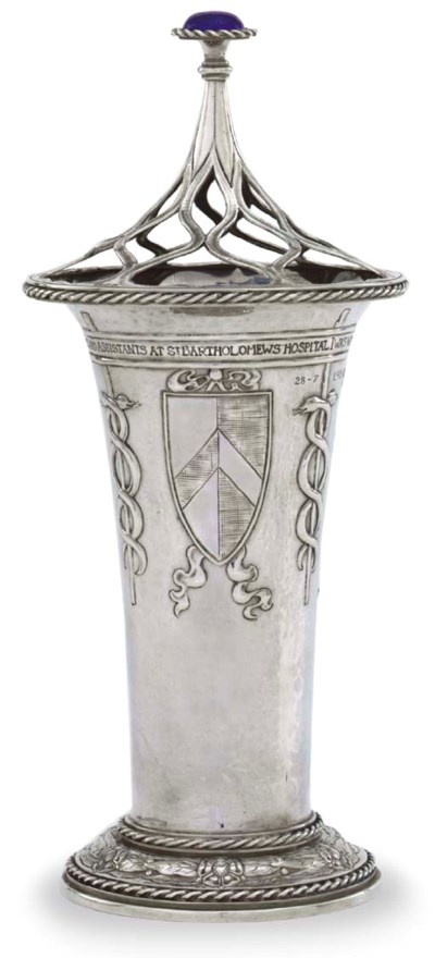 A GEORGE V SILVER VASE AND COV