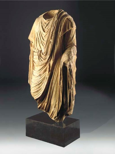 AN OVER LIFE-SIZE ROMAN MARBLE