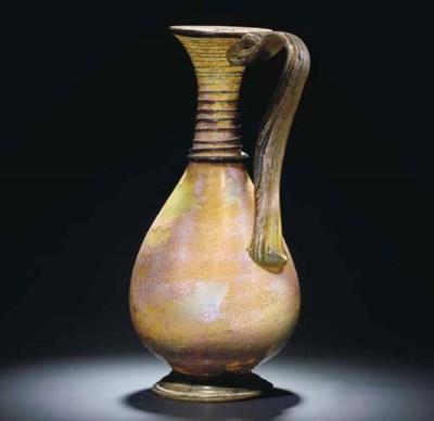 A LARGE ROMAN GREEN GLASS JUG