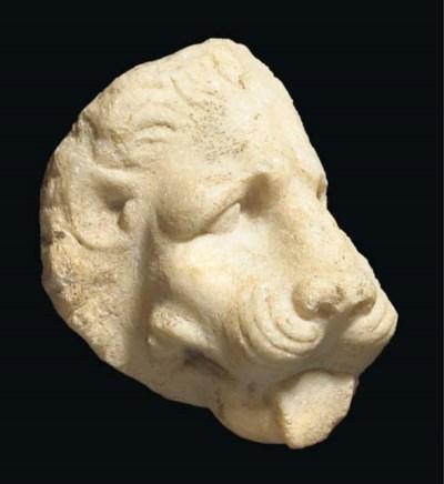 A GREEK MARBLE LION HEAD PROTO