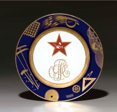 A Soviet propaganda porcelain plate, by the Imperial Porcelain Factory, period of Nicholas II, 1897, with later blue overglaze State Porcelain Factory jubilee mark of cog, V, hammer and sickle, dated 1922, numbered 21515. After a design by Mikhail Adamovich. Diameter 9½ in (24.3 cm). Sold for £50,400 on 30 November 2005 at Christie's in London