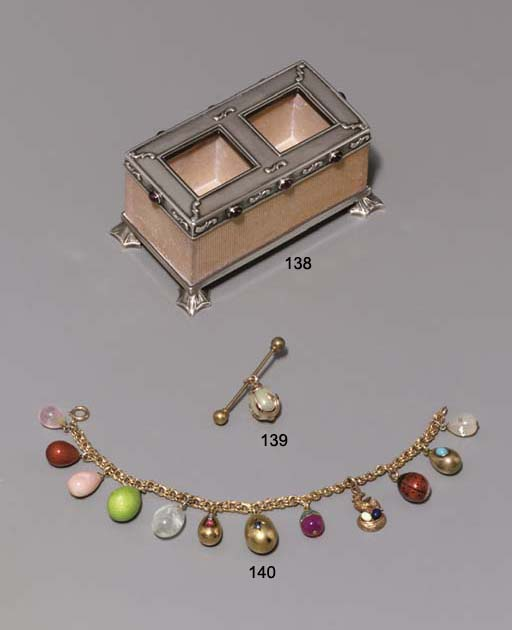 A jewelled silver-mounted brick match-holder