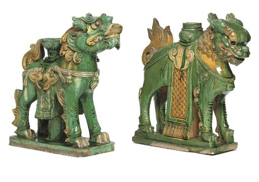TWO CHINESE GREEN AND OCHRE-GLAZED TILEMAKER'S FIGURES OF BUDDHIST LIONS