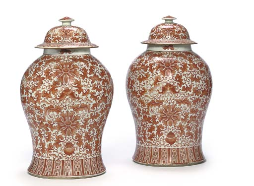 A PAIR OF CHINESE IRON-RED-DECORATED BROAD BALUSTER JARS AND DOMED COVERS