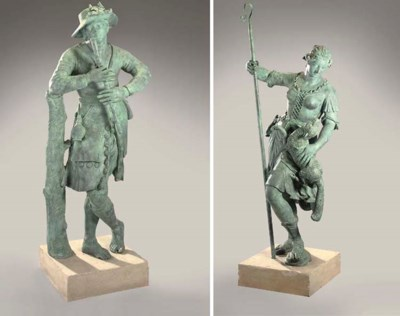 A PAIR OF PATINATED LEAD FIGUR