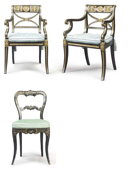 A PAIR OF EBONISED AND PARCEL-GILT OPEN ARMCHAIRS