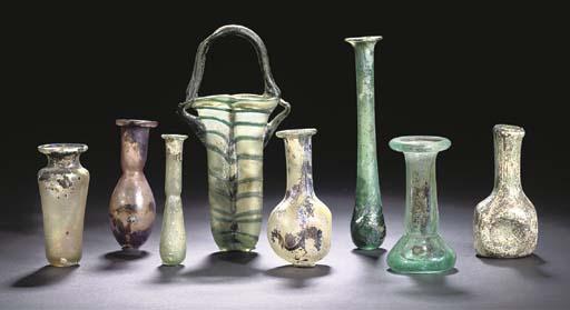 A ROMAN GREEN GLASS BALSAMARIUM