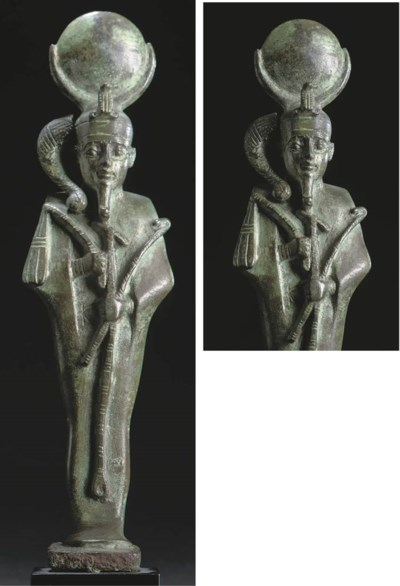 AN EGYPTIAN BRONZE FIGURE OF T