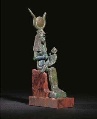 AN EGYPTIAN BRONZE SEATED FIGU