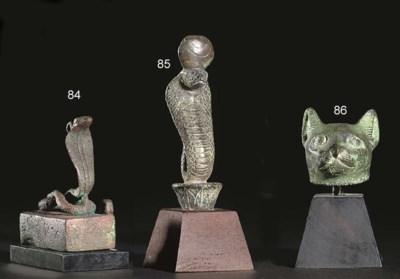 AN EGYPTIAN BRONZE SARCOPHAGUS