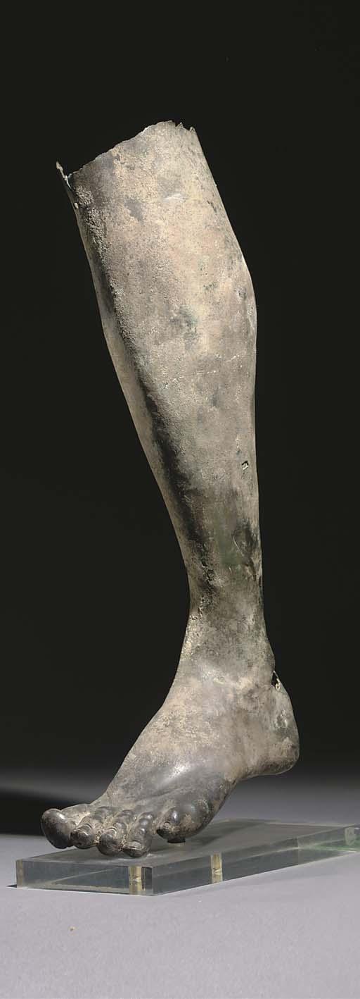 A ROMAN BRONZE MALE LEFT LEG