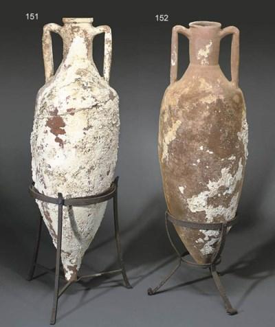 A ROMAN POTTERY WINE AMPHORA
