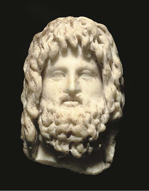 A ROMAN MARBLE HEAD OF ZEUS-SERAPIS