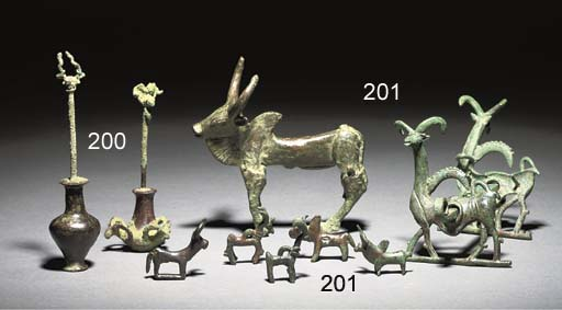 A GROUP OF WESTERN ASIATIC BRONZE VESSELS AND ANIMALS