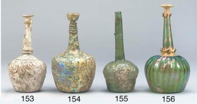 A Nishapur pale green glass bo