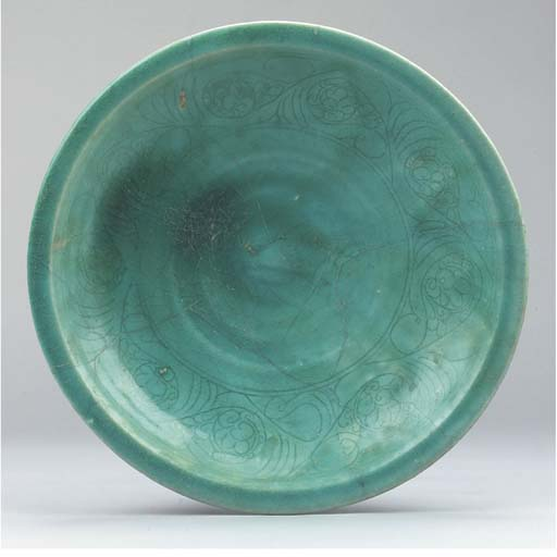 A large turquoise glazed potte