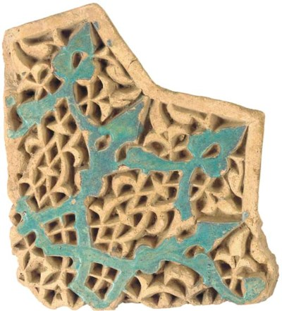 A Timurid carved and glazed st