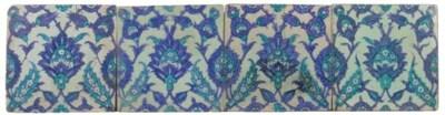Four mounted Iznik square tile