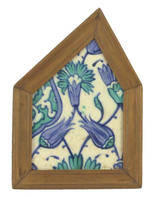 A framed Iznik tile fragment,