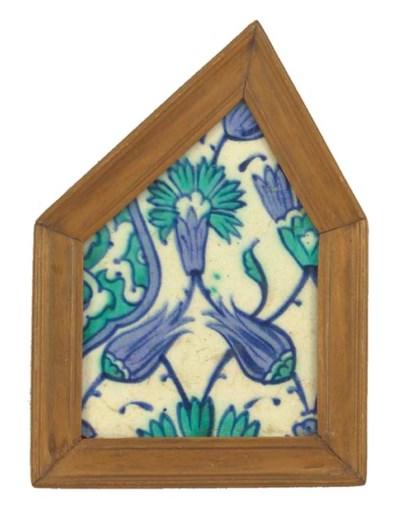 A framed Iznik tile fragment,