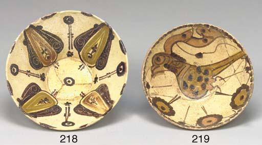 A Nishapur flaring pottery bow