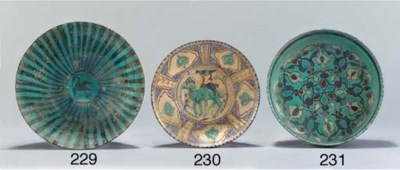 A Kashan turquoise and black g