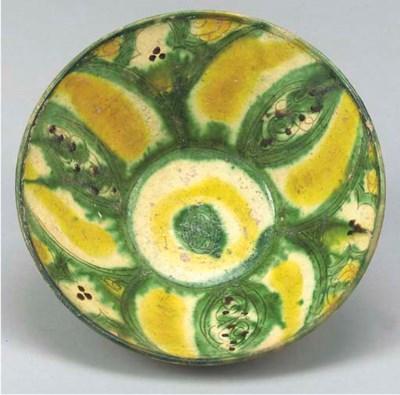 A Nishapur Tang splashed bowl,