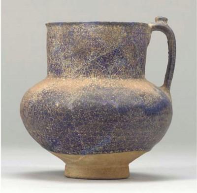 A Kashan cobalt blue jug, Cent