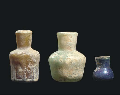 Three small glass bottles, Ira