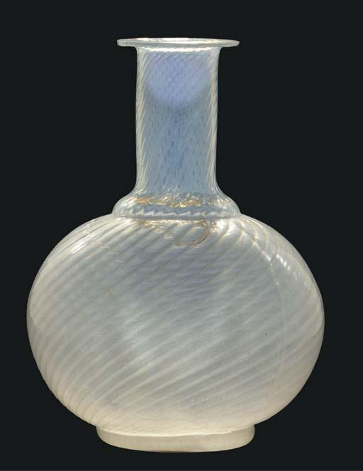 A clear glass bottle vase, Ind