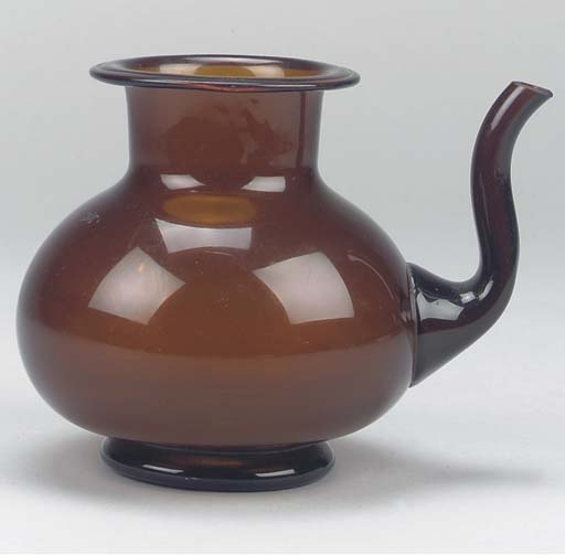 An amber coloured glass pourin