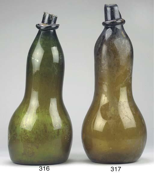 A LARGE GUJARATI OLIVE-BROWN C