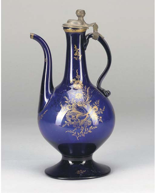 A BLUE GLASS-COLOURED EWER, IR