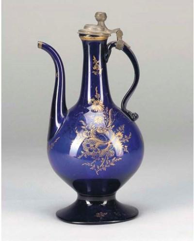 A BLUE GLASS-COLOURED EWER, IR