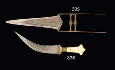 AN IVORY AND DAMASCENED DAGGER