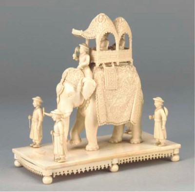 A CARVED IVORY MODEL OF AN ELE