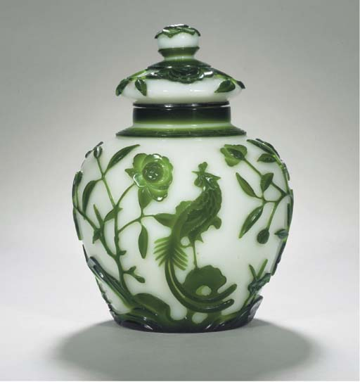 A green and white overlay vase