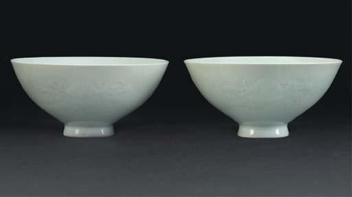 A pair of pale celadon glazed