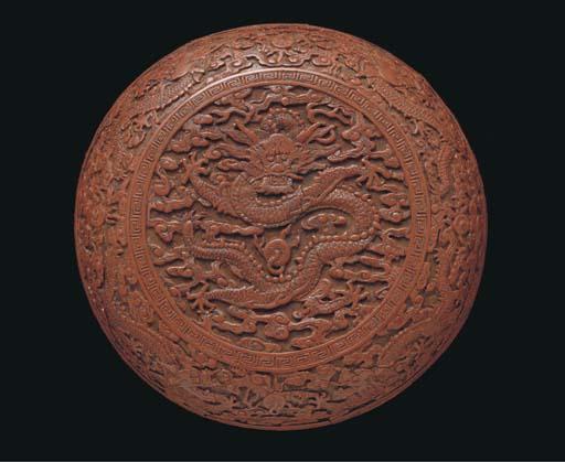 A carved cinnabar lacquer circ