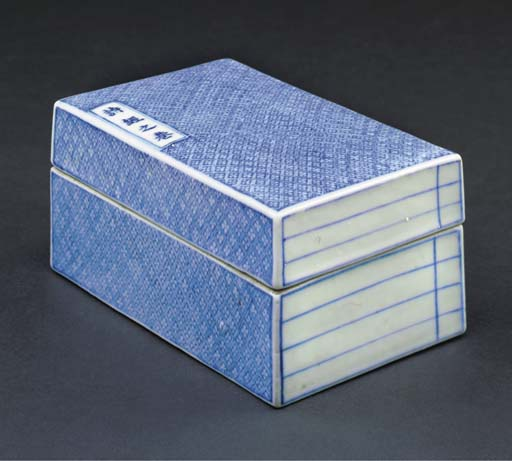 A blue and white book-form box