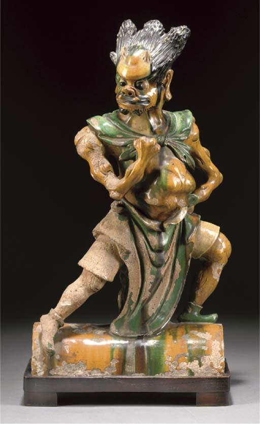A sancai glazed rooftile figure of a Lokapala, Late Ming Dynasty